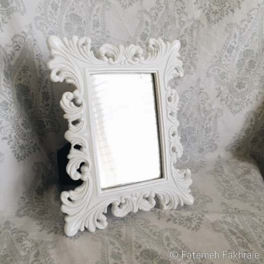 White frame mirror